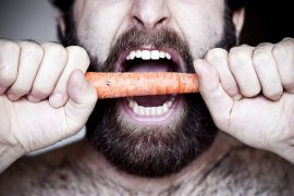 man eating carrot