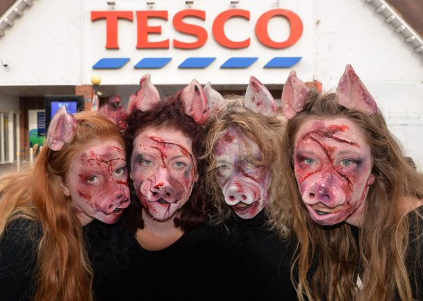 activists, pigs, pig masks, shoppers, children, meat, tesco, shoppers